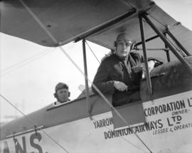 Chief Constable McRae of Richmond at airport [in cockpit of biplane]
