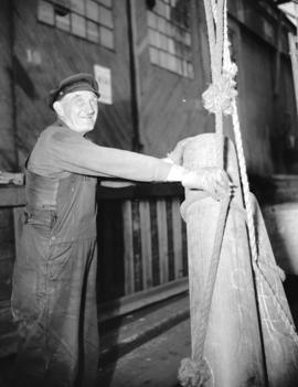 [Man securing a rope at] Pacific Terminal