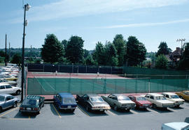 View across tennis courts to site