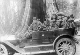 [Mr. J.A. McRae and others in front of the Hollow Tree]