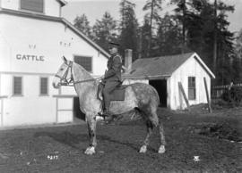 58th C.F.A. [man in uniform mounted on horseback - Exhibition grounds]