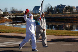Day 25 Torchbearer 28 Brent Jacob carrying the flame in Port Elgin, New Brunswick