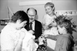Mike Harcourt, [Leora Apsouris] and child visiting with the Vancouver Centennial baby [Cheryl Lyn...