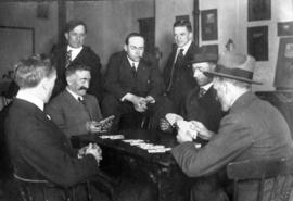 [James Crookall playing cards with a group of men]