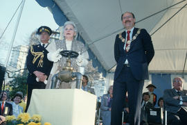 Jeanne Sauvé turning the valve of the Jubilee Fountain with Mayor Harcourt standing beside