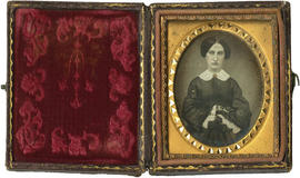 [Daguerreotype of unknown woman in oval gold frame, leather cased]
