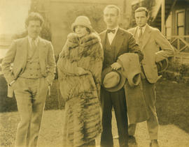 [Group portrait showing Ken Taylor with unidentified men and woman]