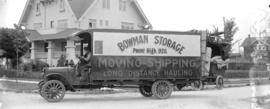[Bowman Storage Moving Truck and driver in front of house at corner of Hudson and Laurier Avenues]