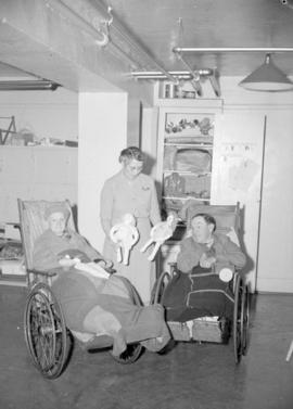 [Woman with two people in wheelchairs at Vancouver Occupational Industries]