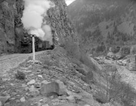 C.N.R. [Canadian National Railway] train [emerging from] tunnel [near] Hell's Gate