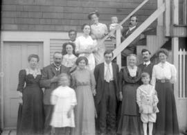 [John, Annie, Jack and Jean Davidson and others beside a house]