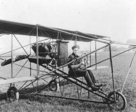 [Murton A. Seymour at the controls of William Stark's airplane at Minoru Race Track]