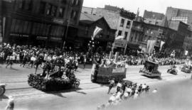 [The Birks, Columbia Theatre and Vancouver Trunk floats in the Dominion Day Parade]