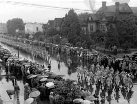 Military band and armed forces marching in Canada Pacific Exhibition's All Out for Victory Parade