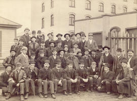[Group portrait of B.C. Sugar Refinery employees in front of Raymur Avenue entrance]