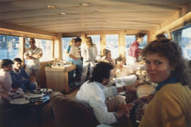 Group indoors on boat cruise