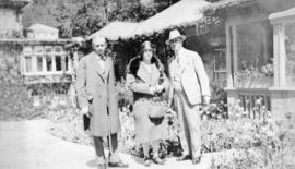 [Unidentified man, unidentified woman and L.D. Taylor at] Butchart Gardens