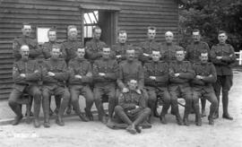 [N.C.O.s of XI Canadian Field Ambulance outside Haig Hutments at Twizeldown Camp]