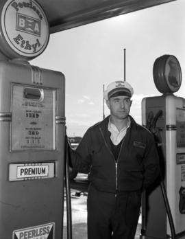 [Harry Howe's service station attendant standing at the pump]