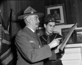 [Portrait of two members of the Boy Scouts looking at a picture]
