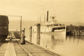 [A ferry at dock]