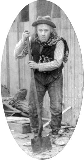 [Alfred T. Layne, actor, in role of old village idiot with shawl]