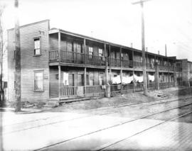 [Apartment building at corner of Fir Street and 3rd Ave W]