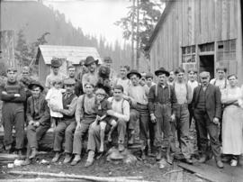 [Group of men, with children and dogs, assembled outside Fraser Valley Sawmill]