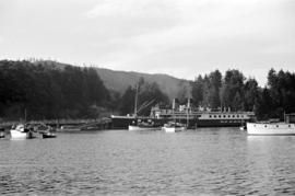 "[""Lady Alexandra"" at dock in Snug Cove]"