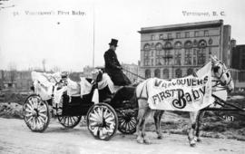 Vancouver's first baby [as grown woman in carriage on Hornby Street]
