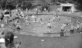 [Children playing at the Second Beach playground pool]