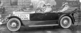 "[Four men in automobile with ""Love Special"" written on the side - silent film star Wall..."