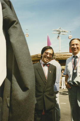 Two men wearing medals during Vancouver Day celebrations at the Expo Site