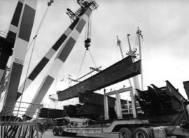 300 ton crane at Centennial Pier, unloading 145 feet, 90-ton curved steel beams, for use on Portl...