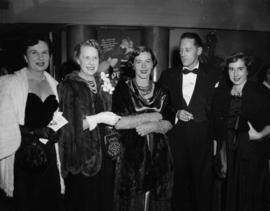 Holly Maxwell and Hugh Pickett with four unidentified women