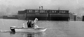 Tow boat operators Hugh Gwynn and Jim Hutton picketing from power boat on North Vancouver waterfront