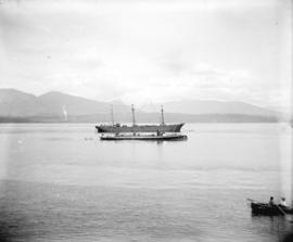 "[C.P.R. coal hulk ""Robert Kerr"", next to a torpedo boat in Burrard Inlet]"
