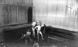 [Group of men inside Burdis and Jones' floating swimming bath at the foot of Thurlow Street]