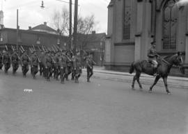 68th C.F.A. [soldiers marching behind officer on horseback]