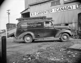 [Industrial Electricians truck parked outside the W.R. Carpenter (Canada) Ltd. Warehouse]