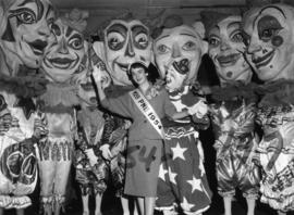 Nancy Hansen, Miss P.N.E., posing with clowns