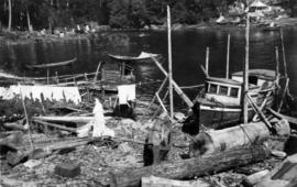 Indian woman [doing laundry at] Charles Creek, Kingcombe Inlet