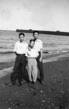 Mrs. Chan's three sons at a beach in Vancouver