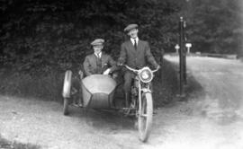 [James Crookall in the sidecar of a motorcycle]