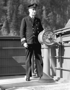 "Chief Officer E.W. Gray [at the helm on the] S.S. ""Prince Rupert"""