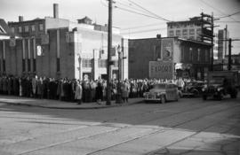 [Crowd lined up in front of a Government Liquor store on Davie Street]