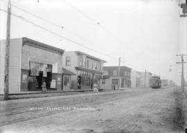[View of streetcar and businesses at] 49th and Fraser Aves. S[outh] Vancouver