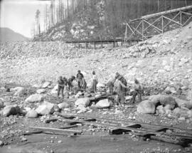[Men clearing rocks at Coquitlam Dam construction site]