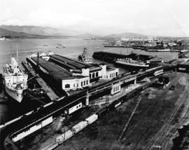[View looking east from the Marine Building showing C.P.R. Pier B-C and Pier D and beyond]