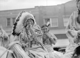 [Two Stoney Indian children on horse back at the Calgary Stampede parade]